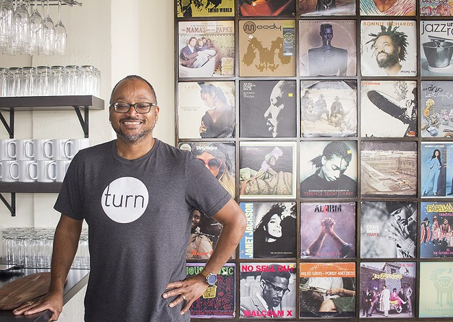 Chef David Kirkland's love of music is evident in the album covers that decorate the space. - PHOTO BY MABEL SUEN