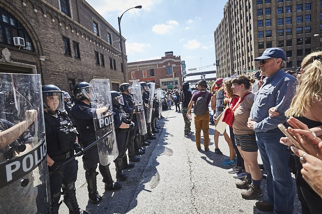 Protesters face off in downtown St. Louis yesterday after the acquittal of a former city cop. - PHOTO BY THEO WELLING
