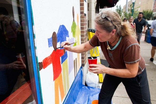 Artist Sophie Binder works at Meshuggah. - COURTESY OF PAINTING FOR PEACE IN FERGUSON, A CHILDREN'S BOOK
