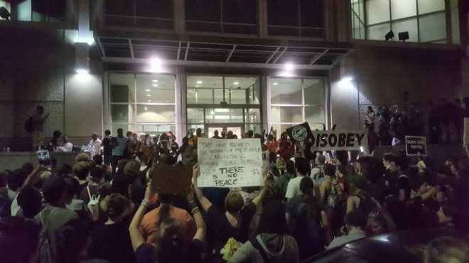 Protesters gather outside the St. Louis Justice Center. - PHOTO BY DANNY WICENTOWSKI