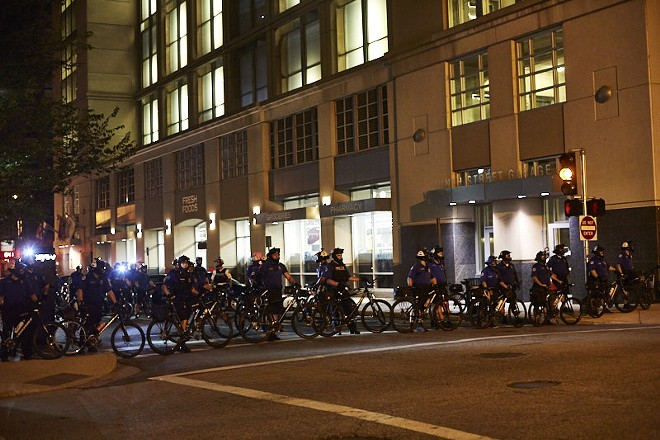 Cops gather outside police headquarters on Sunday, September 17. - PHOTO BY THEO WELLING