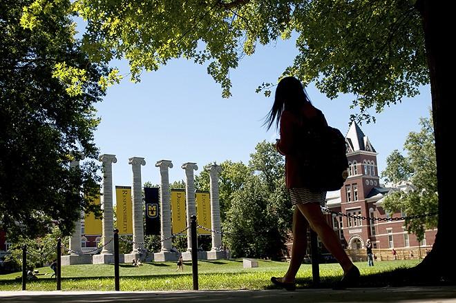 Students walk to class near Mizzou's signature columns. - NICK SCHNELLE/COLUMBIA TRIBUNE