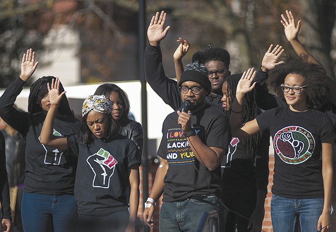 Jonathan Butler, the grad student at the head of the protest movement, speaks with other members of Concerned Student 1950 in November 2015. - NICK SCHNELLE/COLUMBIA TRIBUNE