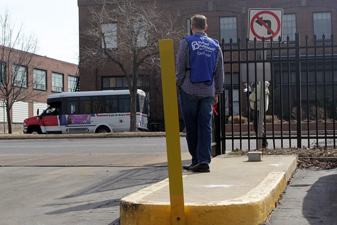 A Planned Parenthood volunteer stands at the entrance of the clinic in the Central West End. - PHOTO BY DANNY WICENTOWSKI