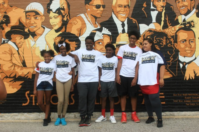 The kids from the Boys and Girls Club pose with the new St. Louis Wall of Fame they created. - PHOTO BY ELIZABETH SEMKO.