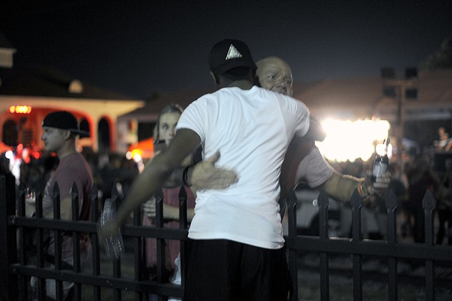 Many revelers were hostile to the protest — but one man offered a hug. - PHOTO BY KELLY GLUECK
