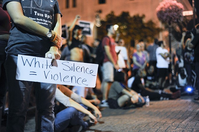 Protesters observed six minutes in silence in the heart of St. Charles. - PHOTO BY KELLY GLUECK