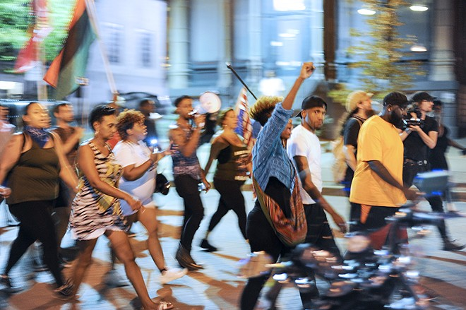 Protesters marched through St. Charles on Friday, September 23. - PHOTO BY KELLY GLUECK