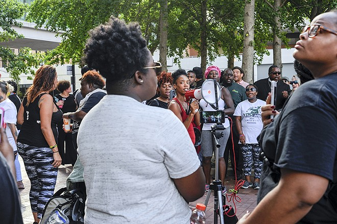 Protesters wait outside the jail for the release of people arrested during a march in the St. Louis Galleria. - PHOTO BY KELLY GLUECK