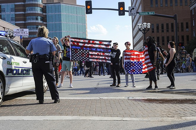 Marchers block an intersection north of the jail. - PHOTO BY KELLY GLUECK