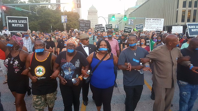 Annie Smith, the mother of the late Anthony Lamar Smith, is at center of a protest through downtown St. Louis on September 25. - PHOTO BY DANNY WICENTOWSKI