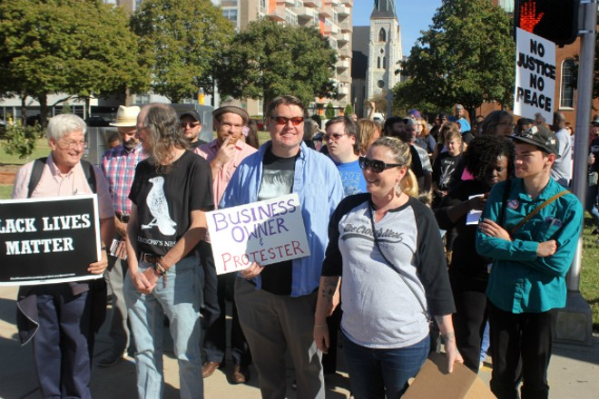 Eliza Coriell, far right, and other business owners joined Friday's protests. - PHOTO BY DOYLE MURPHY
