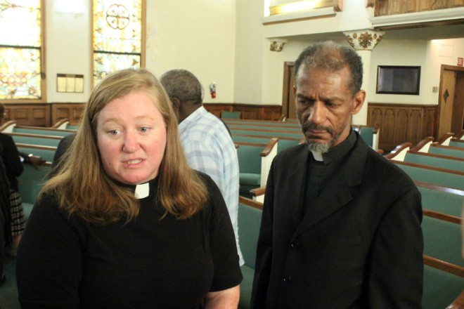 The Rev. Erin Counihan says she was being pushed by police when the Rev. Gray came to her aid. - PHOTO BY DOYLE MURPHY