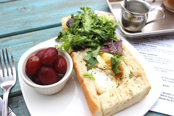 The workday sandwich with soft-boiled egg and greens on baguette. - PHOTO BY LAUREN MILFORD