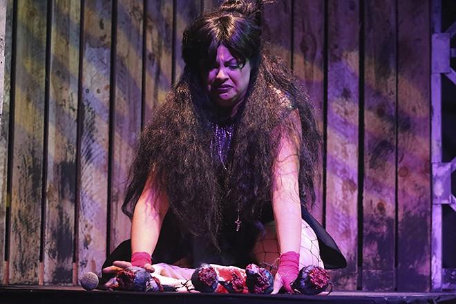 Lizzie Borden (Anna Skidis Vargas) contemplates dead birds and murder. - JILL RITTER LINDBERG