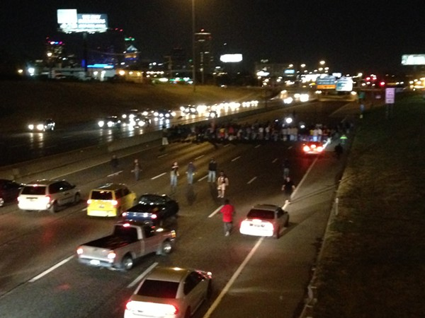Protesters completely blocked traffic on I-64/40 eastbound near downtown St. Louis on Tuesday, October 3. - PHOTO BY DOYLE MURPHY