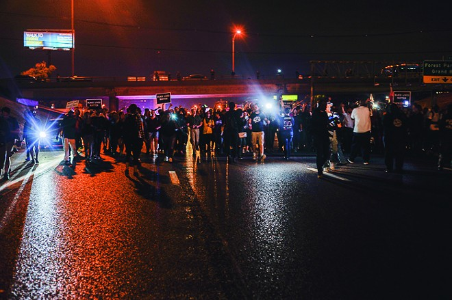 Protesters block I-64/40 in St. Louis on Tuesday, October 3. - PHOTO BY KELLY GLUECK