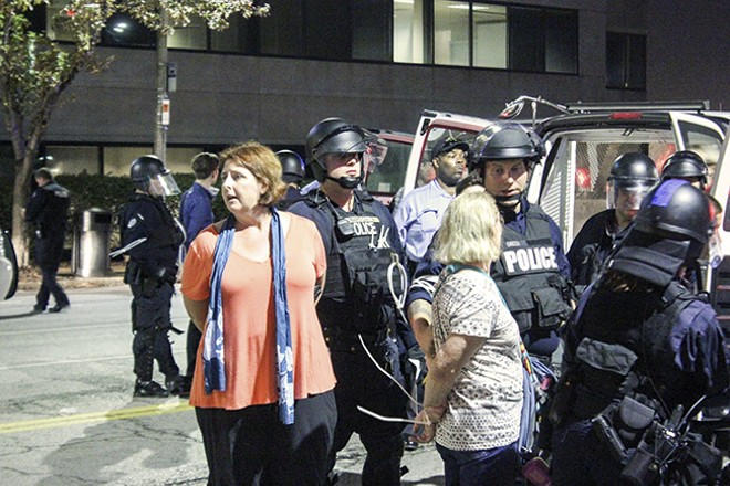 A total of 143 people were arrested on October 3 after they blocked a section of Interstate 64/40. - DOYLE MURPHY