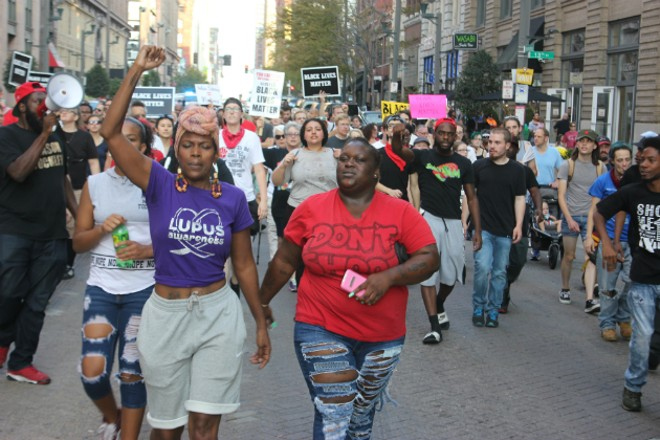 Melissa McKinnies (left) and Ebony Williams lead protesters along Washington Avenue. - PHOTO BY DOYLE MURPHY
