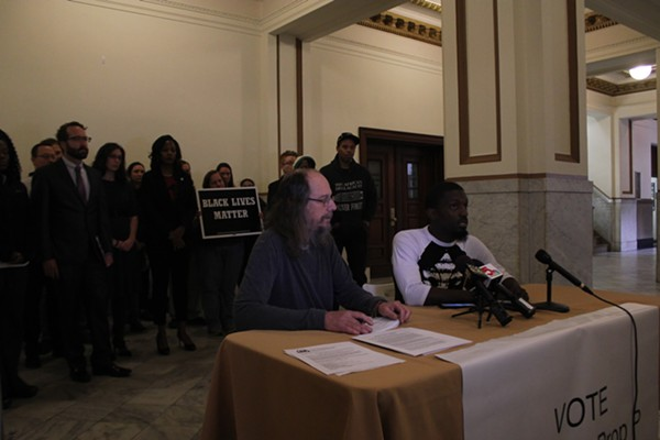 Bruce Franks (with John Chasnoff, left) calls for accountability in the St. Louis police department before city voters increase the sales tax. - KATIE HAYES