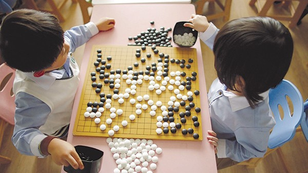 An AI challenges the world's best player of the Japanese game Go in Alpha Go.
