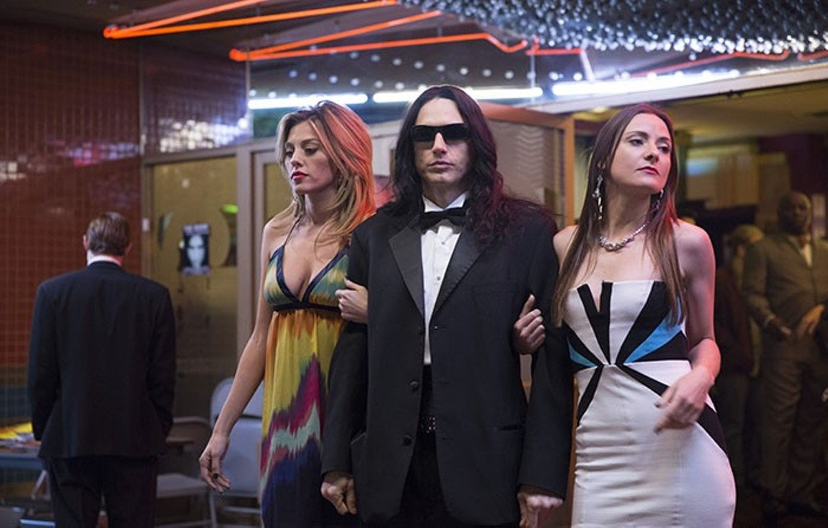 Tommy Wiseau (James Franco, center) and his strange film come to life in The Disaster Artist.