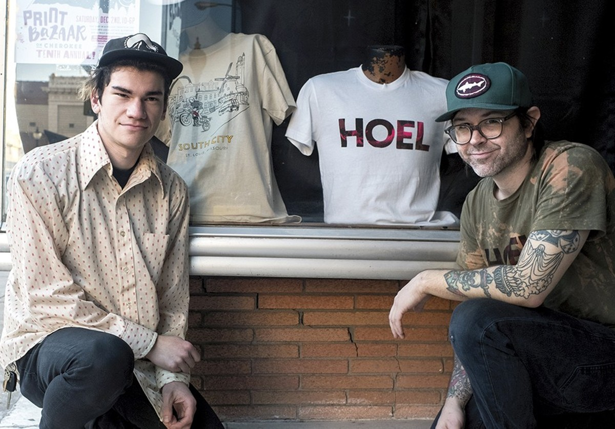 Nathan Prater (right, with Austin Roberts) outside the House of Eight Legs storefront on Cherokee Street.