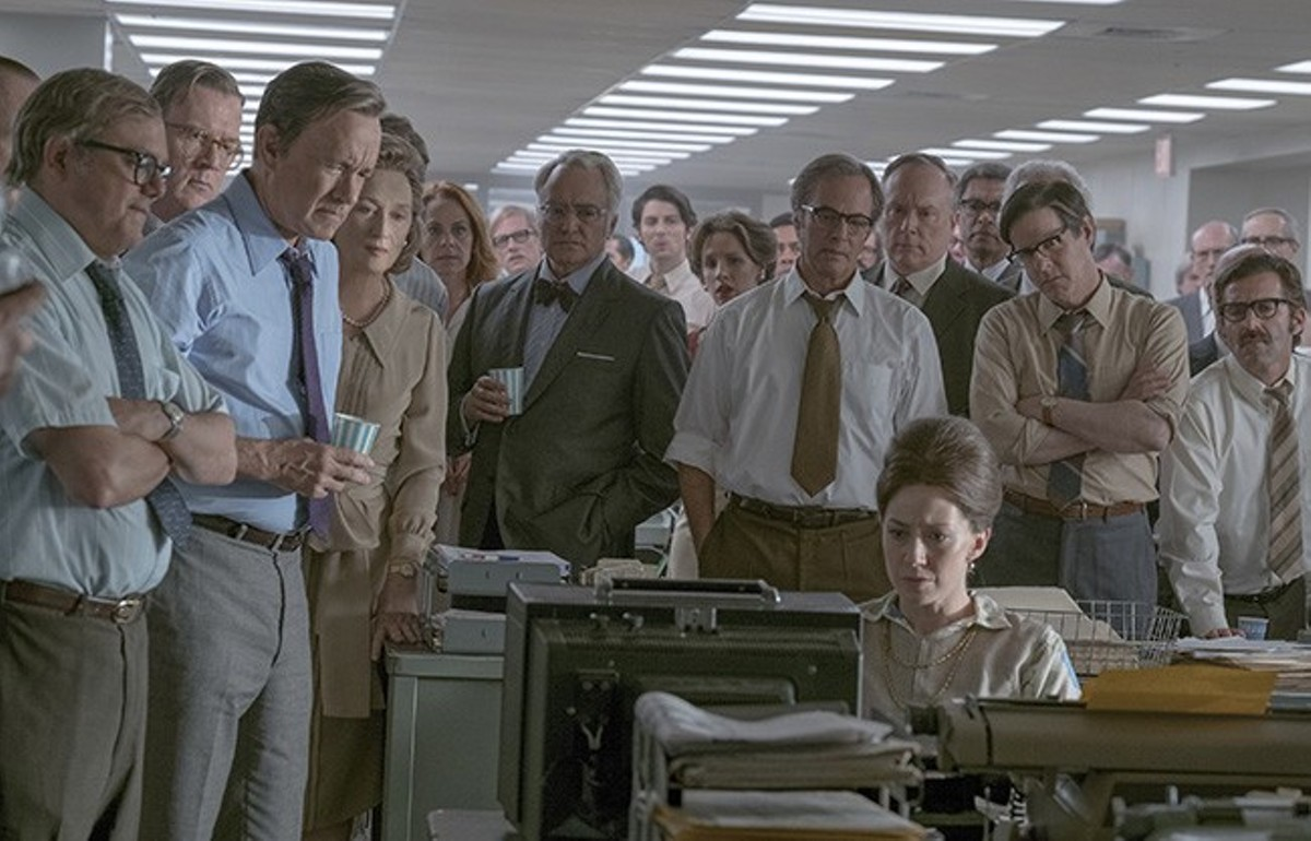 The editorial staff of The Washington Post gathers around the TV to watch the nation respond to its work.