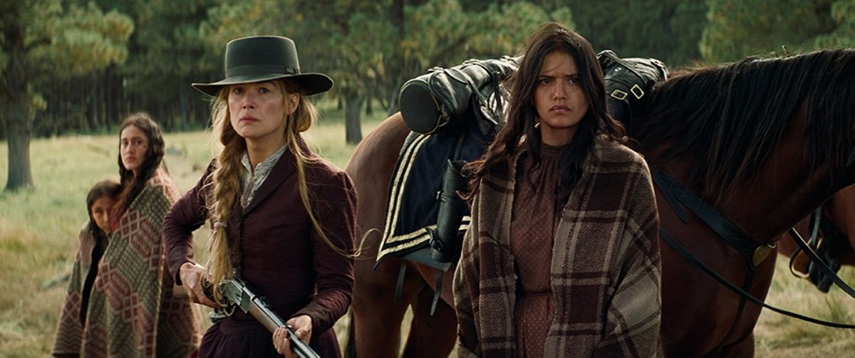Rosalie (Rosamund Pike) has survived a massacre; now she has to survive a long trip with Christian Bale.