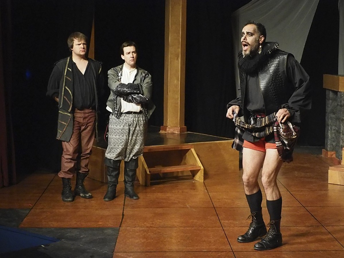 Guildenstern and Rosencrantz (Ted Drury and Robert Thibaut) observe the Player's (Isaiah Di Lorenzo) latest lesson.