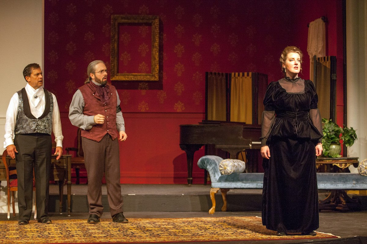 Judge Brack and Ejlert (John Reidy and Ben Ritchie) are aghast at Hedda's (Nicole Angeli) latest cruelty.