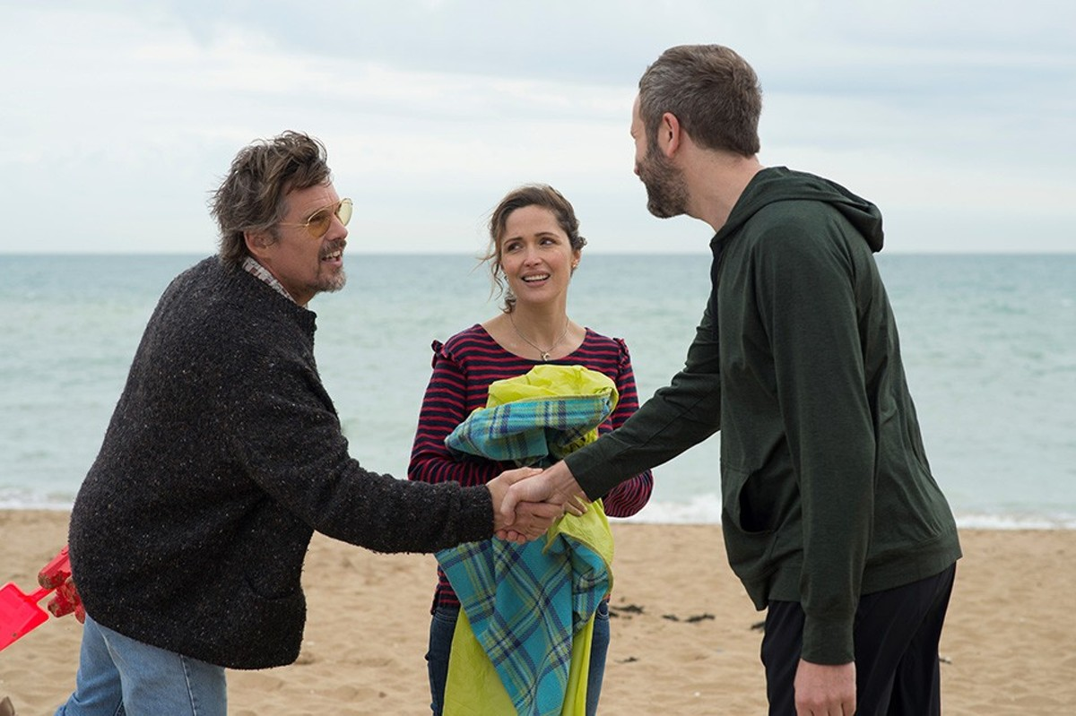 Tucker Crowe (Ethan Hawke) meets his biggest fan, Duncan (Chris O'Dowd), as Annie (Rose Byrne) watches nervously.