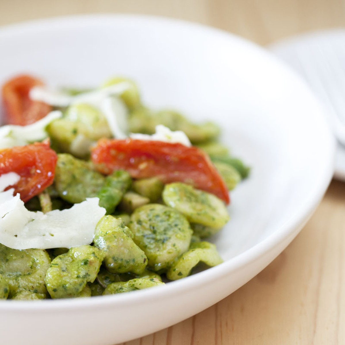 Hand made pasta - Orecchiette, asparagus, mushrooms, roasted tomatoes, spinach pesto and asiago.