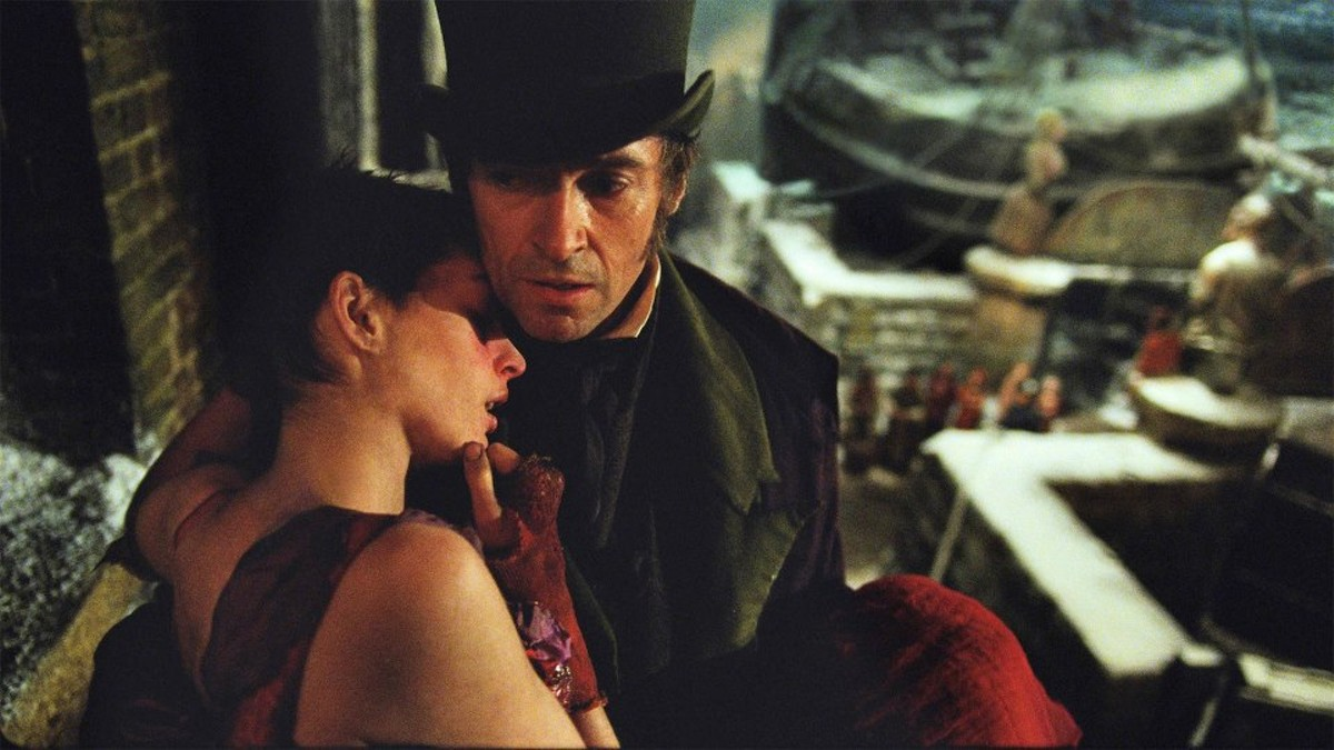 Les Miserables stays true to itself onscreen. A very ill Fantine (Anne Hathaway) is held by Jean Valjean (Hugh Jackman).