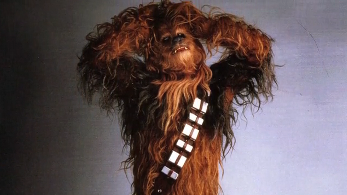 Inside that famous furry costume is Peter Mayhew.