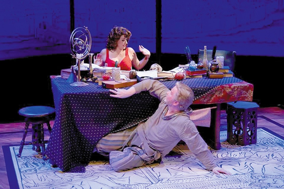 The courtesan (Caitlin Mickey) gives in to the seductive charms of Faustus (Steve Isom).
