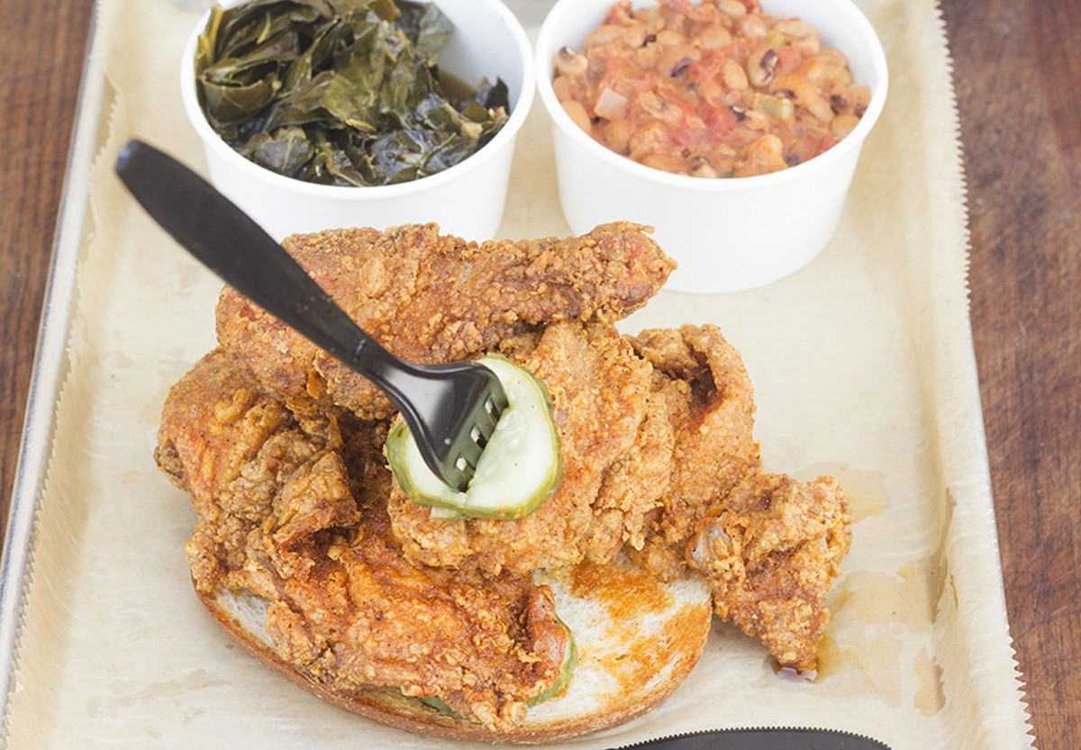 Hot Chicken plate with Southern greens and Hoppin' John.