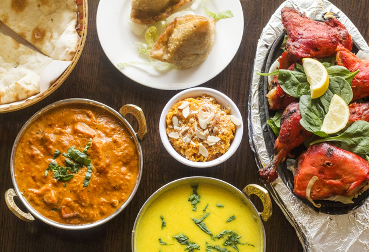 Dishes at Aroma Grill include samosas, butter chicken, gazar halwa, tadka daal and tandoori chicken.