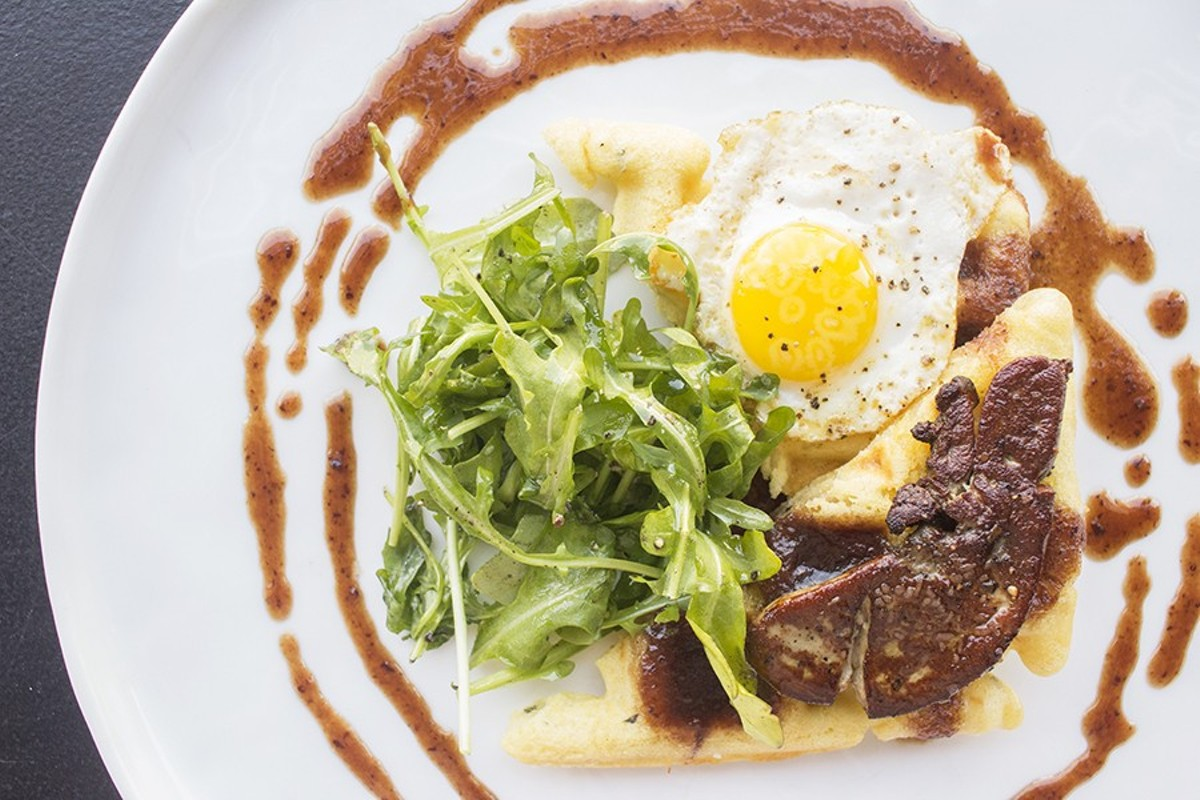 """The """"Foie 'n' Waffle"""": Seared foie gras, rosemary waffles, quail egg, arugula and port wine red currant syrup."""