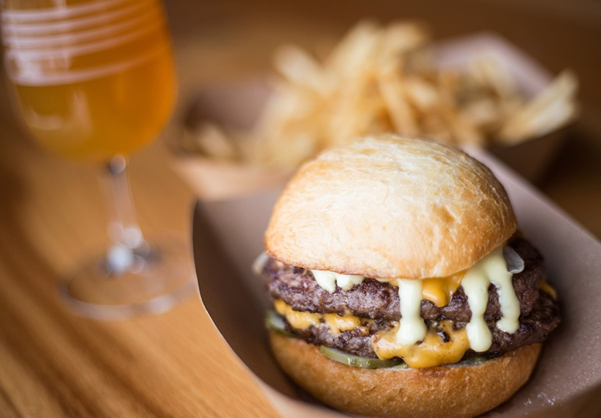The burger is topped American cheese, pickles and dijonnaise and served on a brioche bun.
