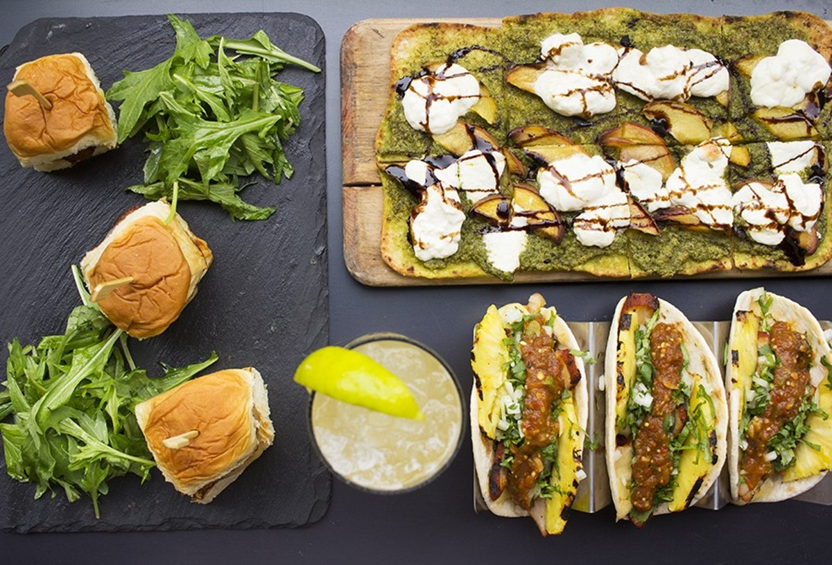 "A selection of items from Scapegoat: ""G.O.A.T. Sliders,"" peach and burrata flatbread, and tacos."