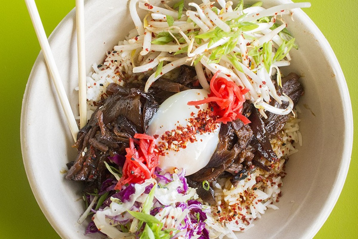 Gyudon with soy-dashi braised Missouri beef, slow-cooked egg, seasoned rice, cabbage and togarashi.