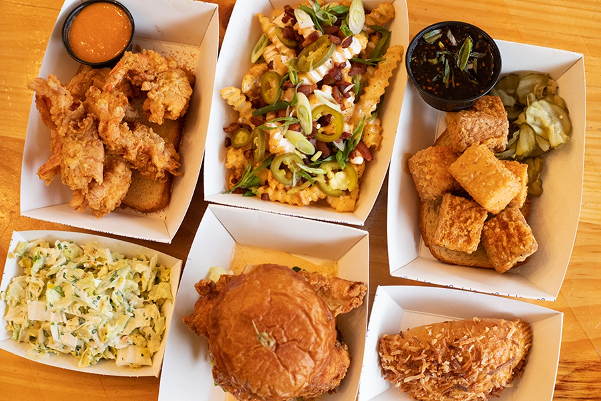 A selection of items from Grace Chicken + Fish, pictured from left to right and top to bottom: shrimp, garlic loaded fries, tofu, creamy slaw, chicken sandwich and a hand pie.