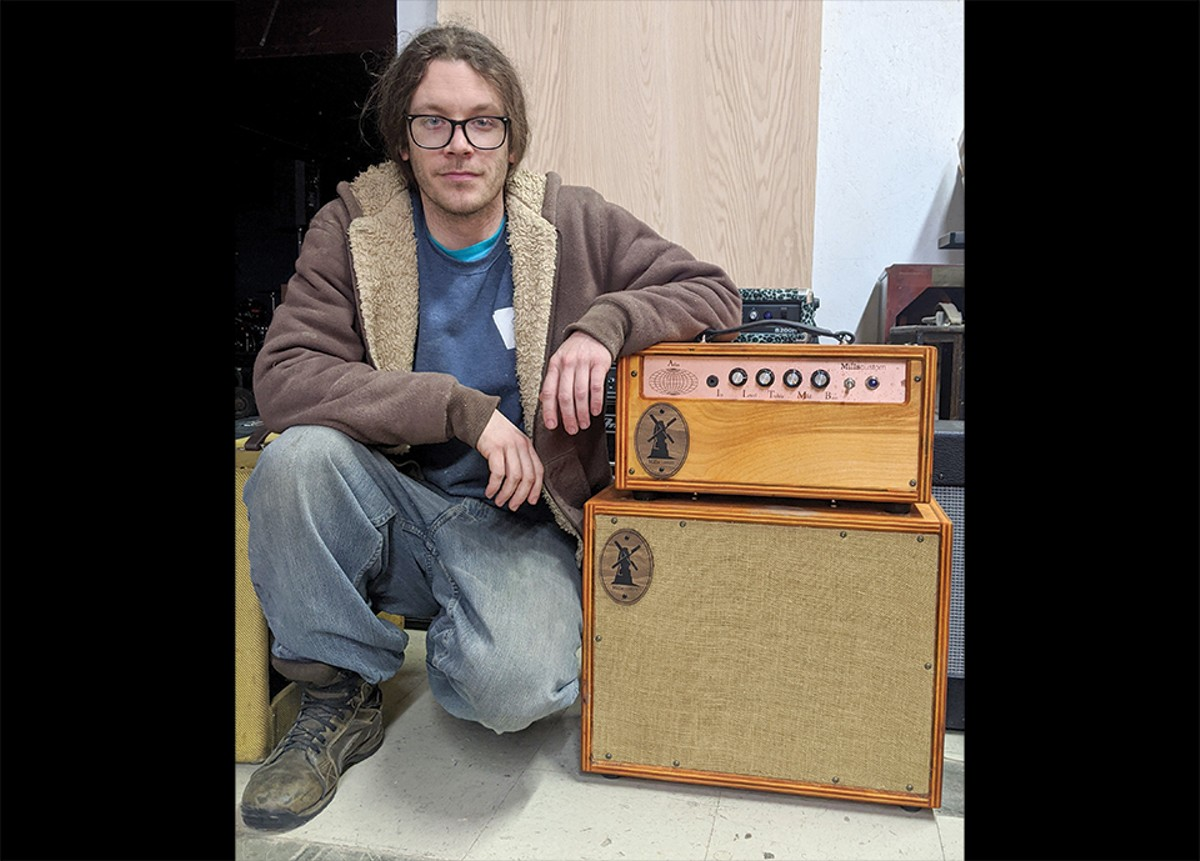 Justin Mills poses with one of his creations, a 50 watt Atlas amplifier with a 1x12 cabinet.