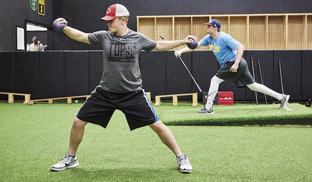Ricky Maddock, a Kirkwood High student, works out at the P3 facility. Behind him is Zack Hunsicker, of Francis Howell High School.