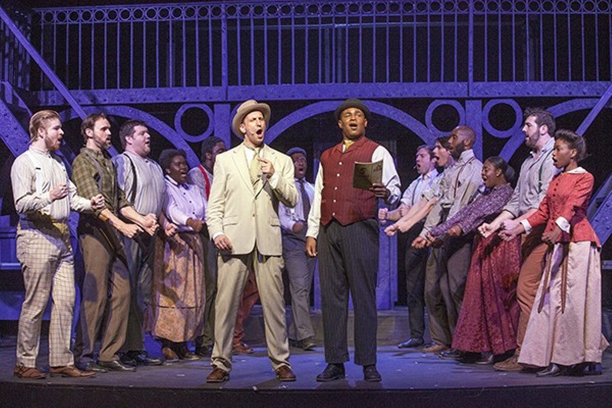 Henry Ford (Jason Meyers) and Coalhouse (Omega Jones) sing about achieving success by never giving up.