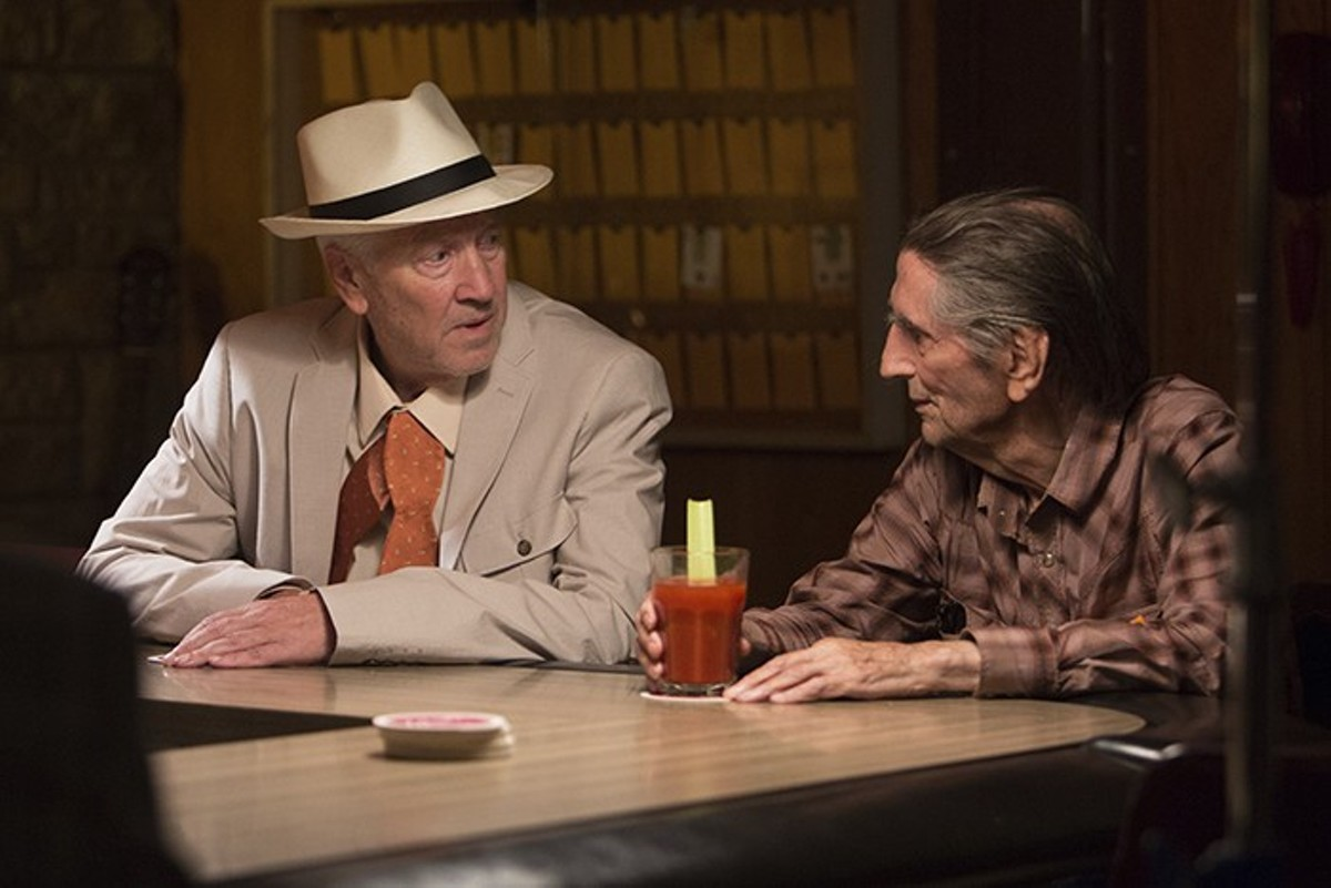Howard (David Lynch) and Lucky (Harry Dean Stanton) shoot the breeze.