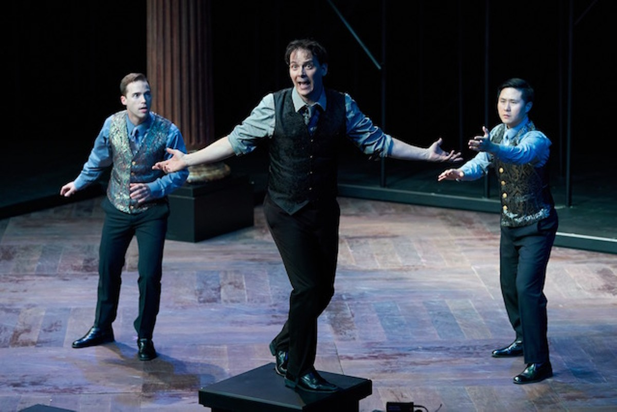 Rosencrantz (left, Ross Cowan) and Guildenstern (right, Stephen Hu) try to figure out how crazy Hamlet (center, Jim Poulos) really is.