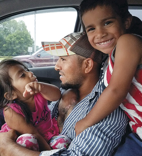 Alex Garcia with his two youngest children. - COURTESY OF ALEX GARCIA