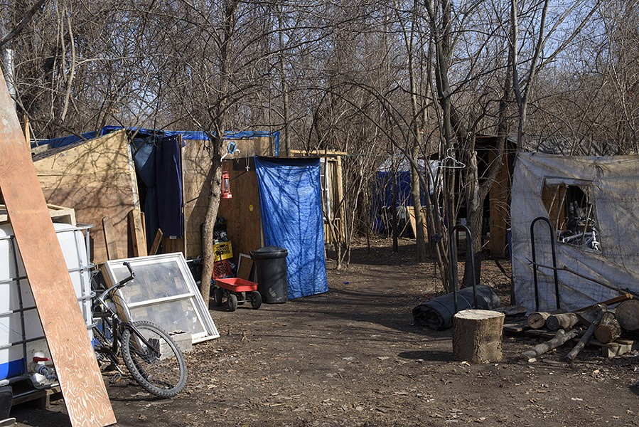 The camp on the east side is just one of many solutions that local homeless people have cobbled together this winter. - NICK SCHNELLE